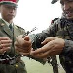 India withdraws troops from disputed Himalayan region, defusing tension with China
