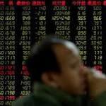 Asian markets mixed as market awaits Trump's Fed decision