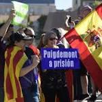 Spain takes control of Catalonia, fires defiant separatist leaders