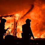 California Fires Kill at Least 10 and Destroy 1500 Buildings