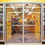 Man locked in store's beer cooler stays, drinks all night