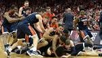 College basketball roundup: De'Andre Hunter's three helps No. 1 Virginia edge Louisville, 67-66
