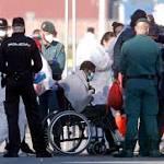 The Latest: UN official: Delay put migrants in 'grave peril'